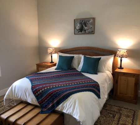 The Guesthouse main bedroom with a double bed
